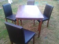A table and 4 chairs