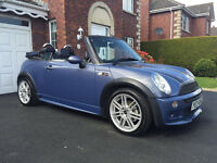 Cool blue Mini cooper convertible with full factory jcw kit