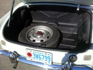 Four early 15 in wheels-will fit MGC and MGB