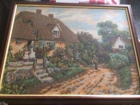 Framed Tapestry picture of a cottage