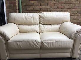 Cream learher sofa 2 seater