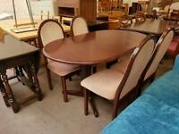 Extending dinning table with 4 fabric cousihend chairs