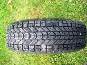 """14"""" WINTER FORCE SNOW TIRE ON 4 HOLE RIM WITH 3 EXTRA RIMS"""