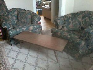 Green chairs, and coffee table in mint condition.