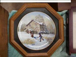 Single Keirstead collector plate with wooden glass frame.