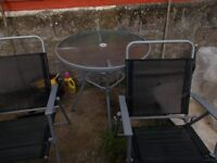 Garden table, 4 chairs + large parasol
