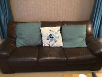 Two Brown leather three seater sofas