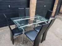 Glass extendable dining table with 6 chairs