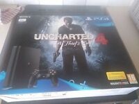 unopened ps4 slim line with uncharted 4 game