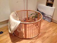 Large circular wooden playpen