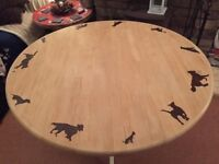 Round Dining Table with Dogs Hand Burnt on Top. White Base, Wood Top