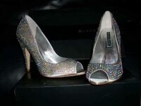 Brand new sparkly silver high heel shoes