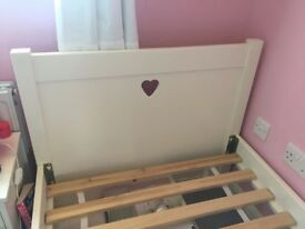 Girls single bed with side table.