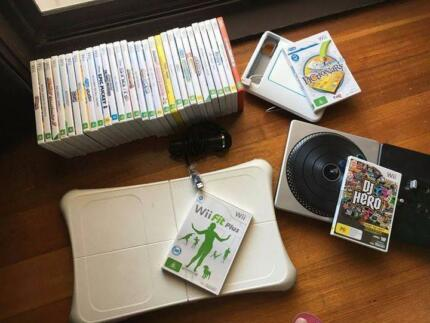 Wii console with accessories and games