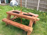 Sleeper picnic table with beer troughs