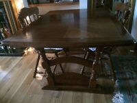 Solid dining table seats 4 or 6 with 4 chairs