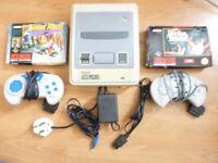 Original SNES + 2 Controllers + 2 Boxed Games