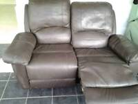 Two seater reclining leather settee