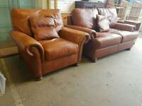 Brown leather 2 seater sofa and armchair with students detail
