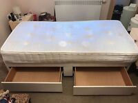 Single bed and mattress . Divan base with drawers