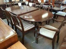 Large extenable dinning table with 6 striped chairs