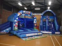 777 bouncy castle hire's up to 3 hour hall package ( disco castle with matching slide )