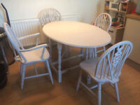 Drop leaf dining table and four chairs