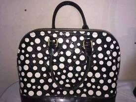 Genuine black and white spotty Louis Vuitton