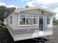 caravan has laminate flooring leather corner sofa and a wood burner and is in lovely condition