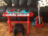 Child's play piano and guitar.