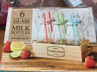 New : Milk bottles in wooden crate 5.00