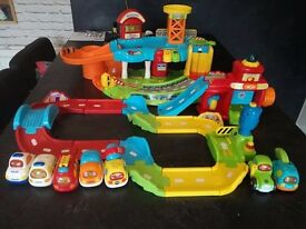 V-TECH TOOT TOOT GARAGE, FIRE STATION, TRAFFIC TRACK AND 7 VEHICLES