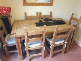 Pine farmhouse rustic table and 6 chairs.