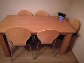 Dining table for sale. It is in very good condition. The table is solid wood.