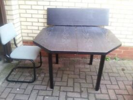 Black extending table and 4 chairs.
