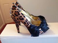 Paris Hilton leopard print shoes