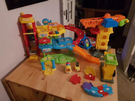 Vtech toot toot drivers garage set and construction site set.
