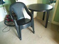 plastic garden table + 3 plastic chairs