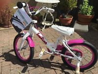 16in pink and white bike.