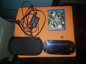 Black PS Vita with 8 gigabyte memory card and Persona 4 Golden