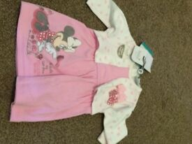 Newborn baby dress with tags.