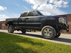 """2004 gmc sierra lifted 6"""" rust free. 5.3 4x4 push button project"""