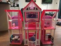 Barbie house with working lift and Barbie dolls