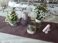 Variety of decorated jars used for wedding in lilac colour tbeme