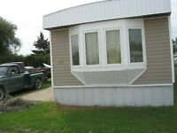 JULY 1st**DAUPHIN 2 BEDROOM MOBILE HOME**