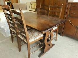 Oak dinning table with four chairs