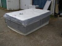 double bed and brand new mattress. and brand new headbords