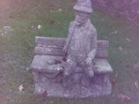 Man on bench stone garden ornament statue