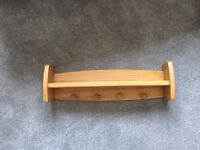 Wooden shelf ideal for baby nursery or child's bedroom