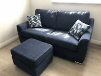 3 seater sofa with a storage footstool and two cushions from DFS